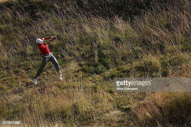 Jordan Spieth of the United States plays a shot from the rough on the tenth hole during the third round of the 115th US Open Championship at Chambers...