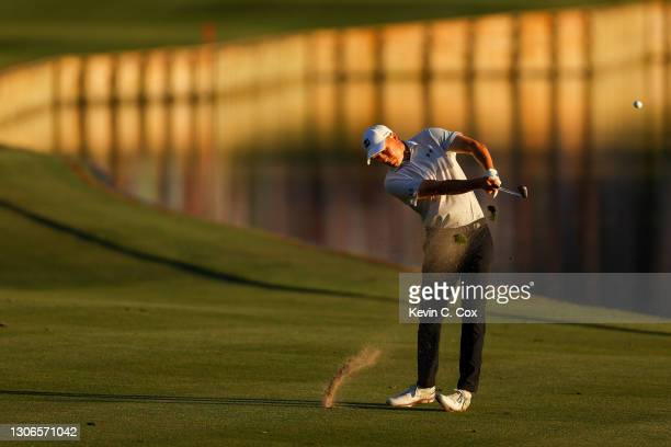 Jordan Spieth of the United States plays a shot on the 18th hole during the first round of THE PLAYERS Championship on THE PLAYERS Stadium Course at...