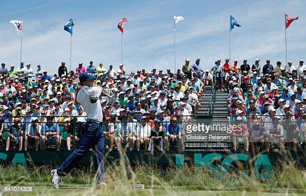 Jordan Spieth of the United States plays a tee shot on the 18th hole during the continuation of the second round of the US Open at Oakmont Country...