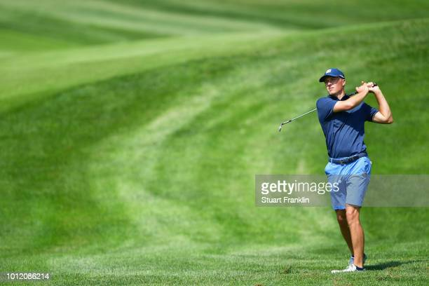 Jordan Spieth of the United States plays an approach shot during a practice round prior to the 2018 PGA Championship at Bellerive Country Club on...
