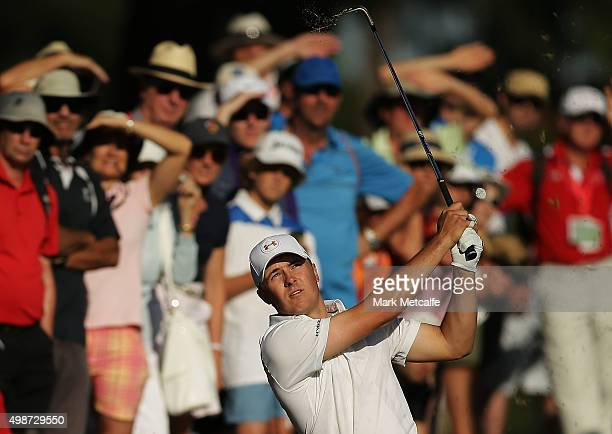 Jordan Spieth of the United States plays an approach shot on the 12th hole during day one of the 2015 Australian Open at The Australian Golf Club on...