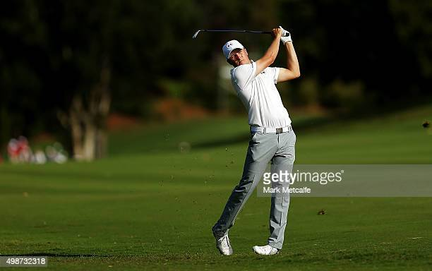 Jordan Spieth of the United States plays an approach shot on the 14th hole during day one of the 2015 Australian Open at The Australian Golf Club on...