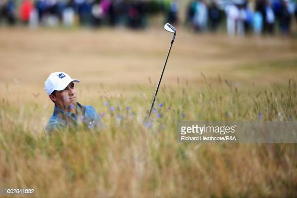 Jordan Spieth of the United States plays from a bunker on the 6th hole during round two of the Open Championship at Carnoustie Golf Club on July 20...