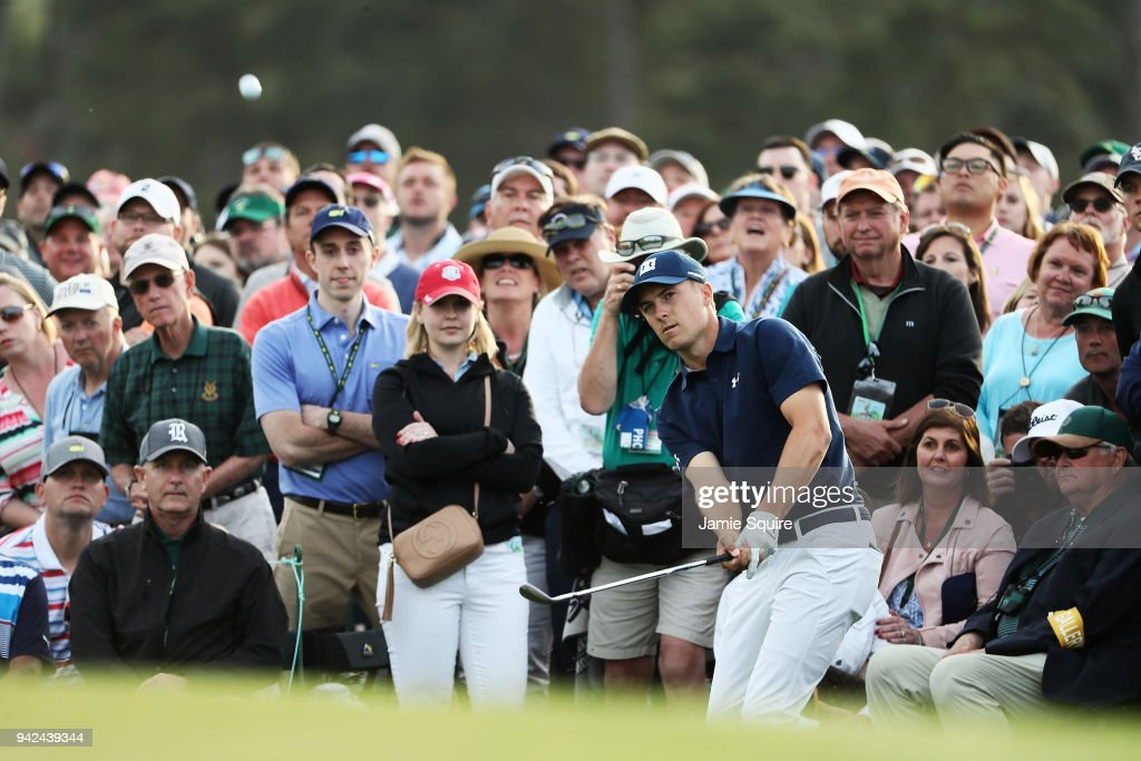 Jordan Spieth of the United States plays his fourth shot on the 18th hole during the first round of the 2018 Masters Tournament at Augusta National Golf Club on April 5, 2018 in Augusta, Georgia.
