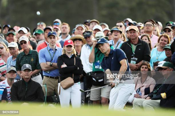 Jordan Spieth of the United States plays his fourth shot on the 18th hole during the first round of the 2018 Masters Tournament at Augusta National...