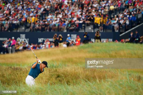 Jordan Spieth of the United States plays his second shot on the 18th hole during the third round of the 147th Open Championship at Carnoustie Golf...