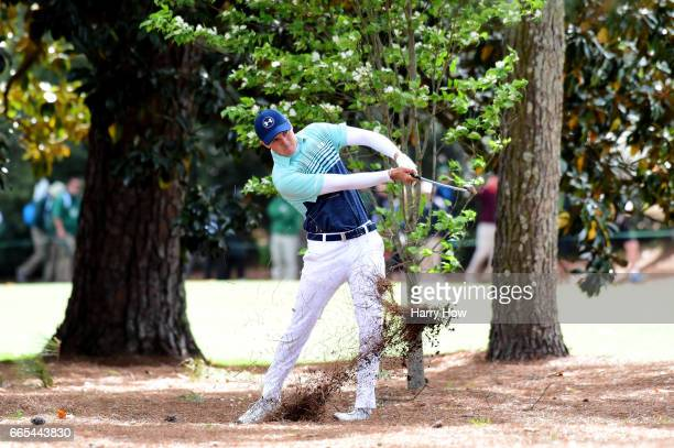 Jordan Spieth of the United States plays his second shot on the 18th hole during the first round of the 2017 Masters Tournament at Augusta National...