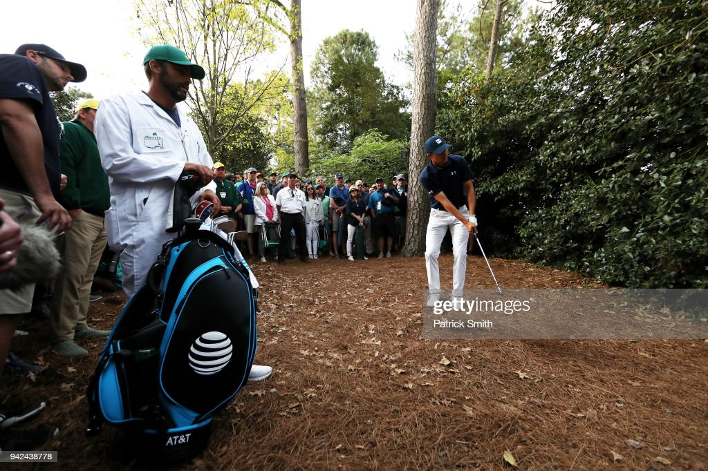 Jordan Spieth of the United States plays his second shot on the 18th hole during the first round of the 2018 Masters Tournament at Augusta National Golf Club on April 5, 2018 in Augusta, Georgia.