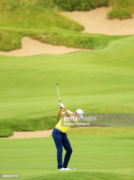 Jordan Spieth of the United States plays his second shot on the fourth hole during the third round of the 2017 US Open at Erin Hills on June 17 2017...
