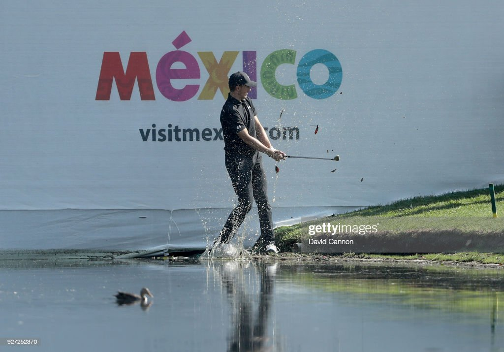 Jordan Spieth of the United States plays his second shot on the par 3, 17th hole from the waters edge during the final round of the World Golf Championships-Mexico Championship at the Club de Golf Chapultepec on March 4, 2018 in Mexico City, Mexico.