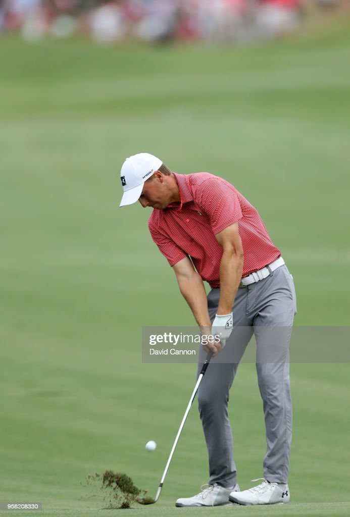 Jordan Spieth of the United States plays his second shot on the par 4, 18th hole during the final round of the THE PLAYERS Championship on the Stadium Course at TPC Sawgrass on May 13, 2018 in Ponte Vedra Beach, Florida.