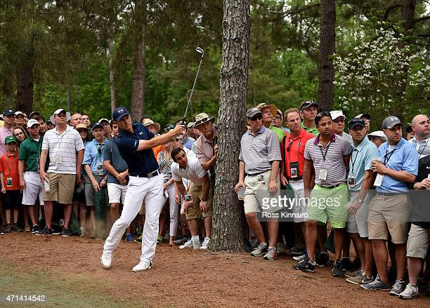 Jordan Spieth of the United States plays his second shot on the par four 11th hole during the final round of the 2015 Masters at Augusta National...
