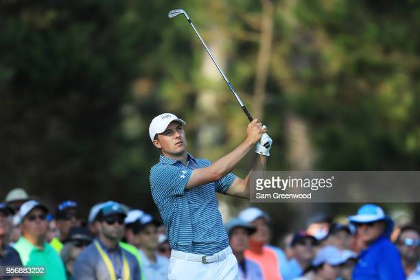 Jordan Spieth of the United States plays his second shot on the tenth hole during the first round of THE PLAYERS Championship on the Stadium Course...
