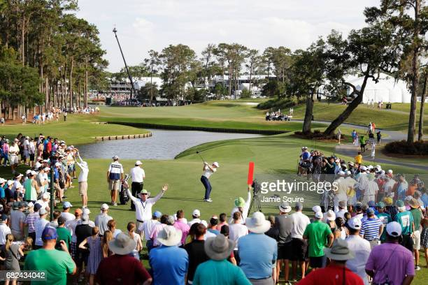Jordan Spieth of the United States plays his shot from the 16th tee during the second round of THE PLAYERS Championship at the Stadium course at TPC...