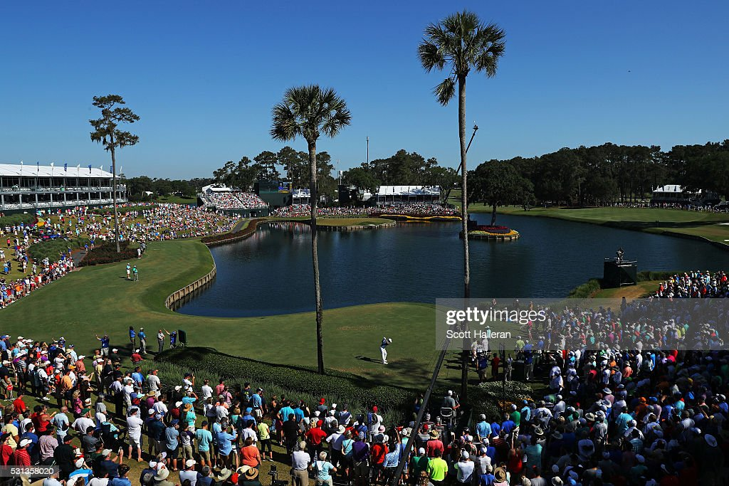 Jordan Spieth of the United States plays his shot from the 17th tee during the continuation of the weather delayed second round of THE PLAYERS Championship at the Stadium course at TPC Sawgrass on May 14, 2016 in Ponte Vedra Beach, Florida.