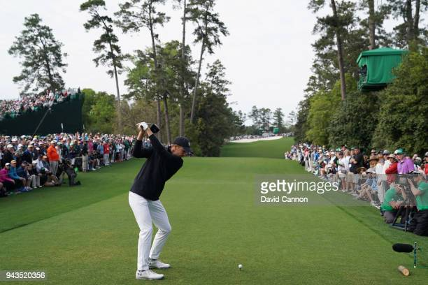Jordan Spieth of the United States plays his shot from the 18th tee during the final round of the 2018 Masters Tournament at Augusta National Golf...
