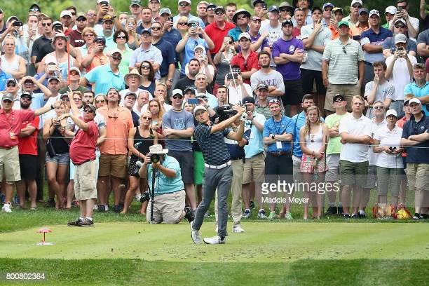 Jordan Spieth of the United States plays his shot from the eighth tee during the final round of the Travelers Championship at TPC River Highlands on...