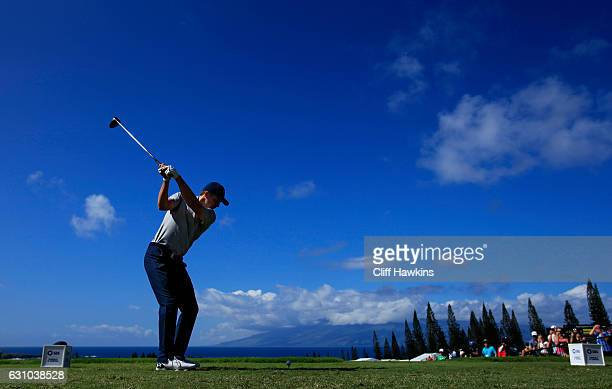 Jordan Spieth of the United States plays his shot from the first tee during the first round of the SBS Tournament of Champions at the Plantation...