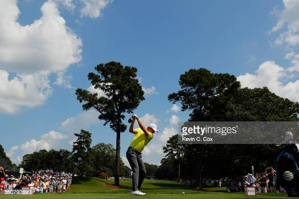 Jordan Spieth of the United States plays his shot from the fourth tee during the first round of the TOUR Championship at East Lake Golf Club on...
