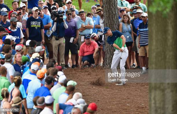 Jordan Spieth of the United States plays his shot out of the pine straw on the 10th hole during the second round of the 2017 PGA Championship at...