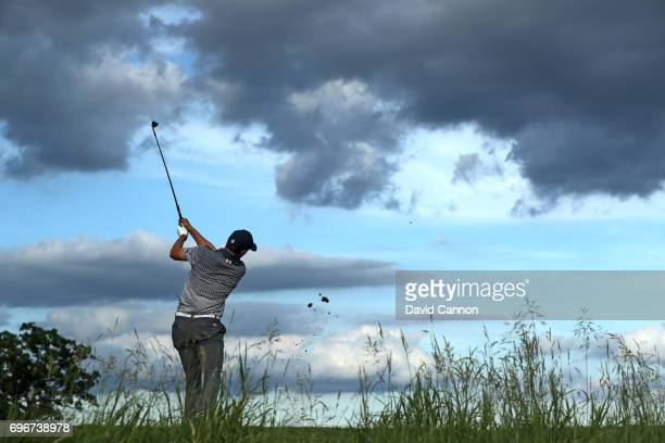 Jordan Spieth of the United States plays his tee shot on the par 3 16th hole during the second round of the 117th US Open Championship at Erin Hills...