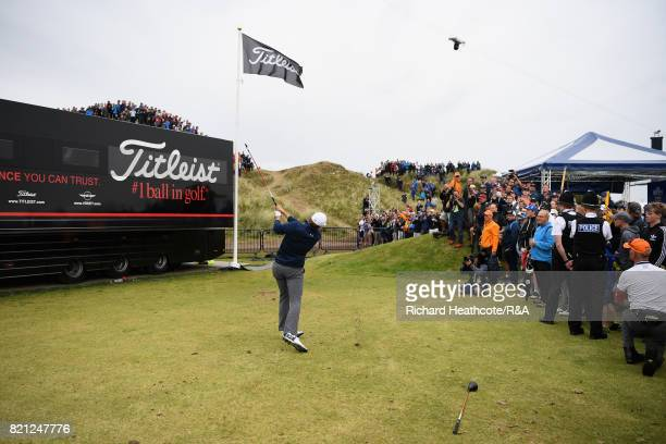 Jordan Spieth of the United States plays his third shot from the practise range after a penalty drop on the 13th hole during the final round of the...