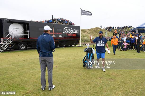Jordan Spieth of the United States plays his third shot from the practice range after a penalty drop on the 13th hole during the final round of the...