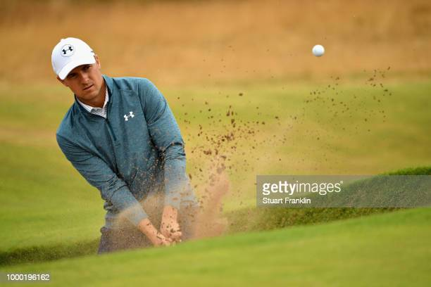 Jordan Spieth of the United States plays out of a bunker on a practice round during previews ahead of the 147th Open Championship at Carnoustie Golf...