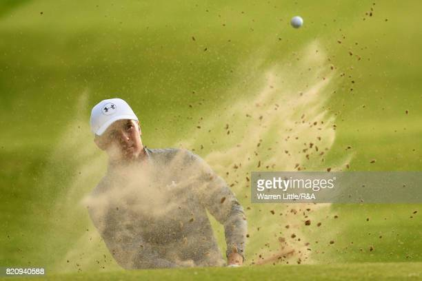 Jordan Spieth of the United States plays out of a bunker on the 17th hole during the third round of the 146th Open Championship at Royal Birkdale on...