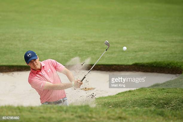 Jordan Spieth of the United States plays out of the bunker on the 1st hole during day three of the Australian Open at Royal Sydney Golf Club on...