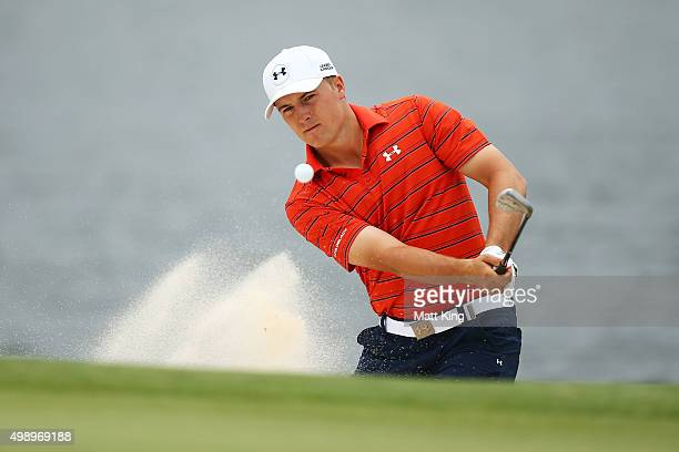 Jordan Spieth of the United States plays out of the bunker on the 4th hole during day three of the 2015 Australian Open at The Australian Golf Club...