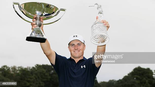 Jordan Spieth of the United States poses on the 18th green after winning both the TOUR Championship By CocaCola and the FedExCup at East Lake Golf...