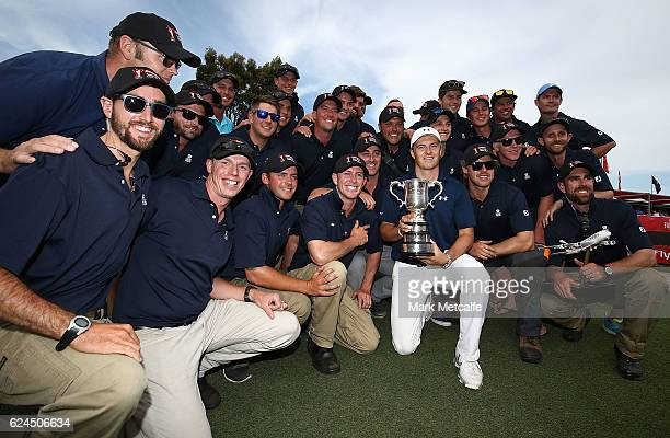Jordan Spieth of the United States poses with greenkeeping staff and the Stonehaven trophy after winning the 2016 Australian Open during day four of...