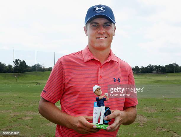 Jordan Spieth of the United States poses with his bobblehead during Round Three at the AT&T Byron Nelson on May 21, 2016 in Irving, Texas.