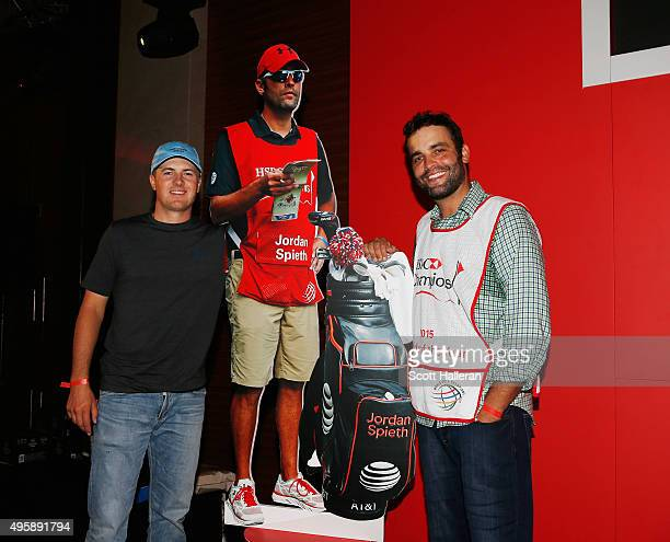 Jordan Spieth of the United States poses with his caddy Michael Greller after Greller was named 2015 Caddy of the Year at the WGC HSBC Champions on...