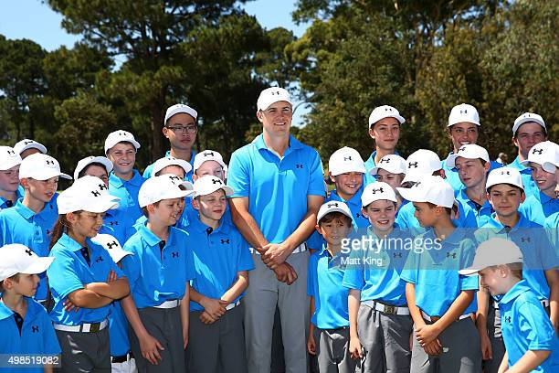 Jordan Spieth of the United States poses with junior Australian golfers after hosting a golf clinic ahead of the 2015 Australian Open at The...