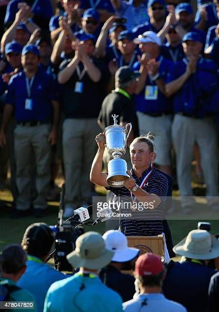 Jordan Spieth of the United States poses with the trophy after winning the 115th U.S. Open Championship at Chambers Bay on June 21, 2015 in...