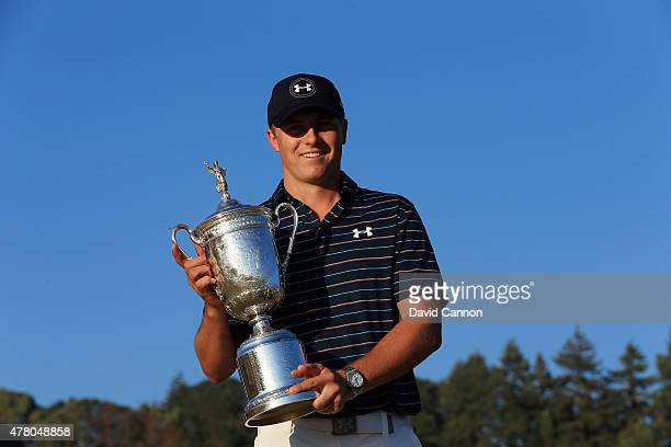 Jordan Spieth of the United States poses with the trophy for photographers after winning the 115th U.S. Open Championship at Chambers Bay on June 21,...