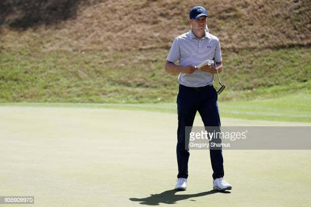 Jordan Spieth of the United States prepares to putt on the 17th green during the first round of the World Golf ChampionshipsDell Match Play at Austin...