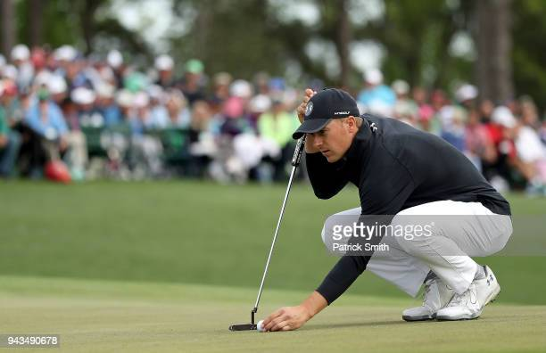Jordan Spieth of the United States prepares to putt on the 18th green during the final round of the 2018 Masters Tournament at Augusta National Golf...