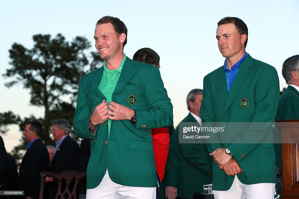 Jordan Spieth of the United States presents Danny Willett of England with the green jacket after Willett won the final round of the 2016 Masters Tournament at Augusta National Golf Club on April 10, 2016 in Augusta, Georgia.
