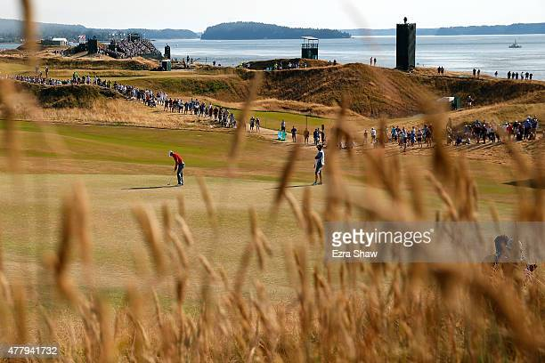 Jordan Spieth of the United States putts on the 11th green during the third round of the 115th US Open Championship at Chambers Bay on June 20 2015...
