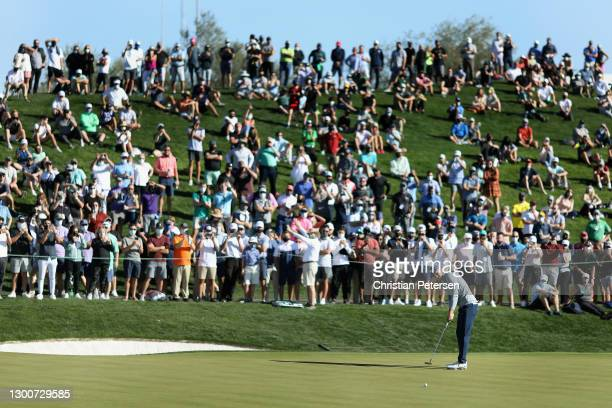 Jordan Spieth of the United States putts on the 18th green during the third round of the Waste Management Phoenix Open at TPC Scottsdale on February...