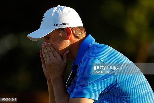 Jordan Spieth of the United States reacts after finishing on the 18th green during the final round of the 2016 Masters Tournament at Augusta National...