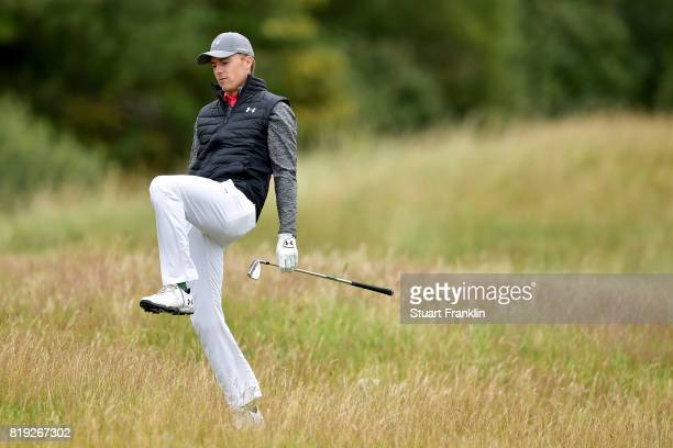 Jordan Spieth of the United States reacts after his approach from the rough on the 5th hole during the first round of the 146th Open Championship at...