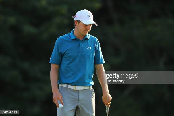 Jordan Spieth of the United States reacts after his bogey on the 18th green during the final round of the Dell Technologies Championship at TPC...
