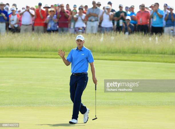 Jordan Spieth of the United States reacts after making a birdie on the 11th green during the first round of the 2017 U.S. Open at Erin Hills on June...