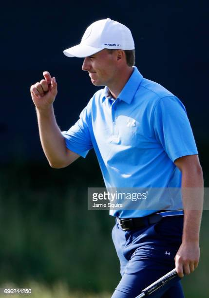 Jordan Spieth of the United States reacts after making par on the tenth green during the first round of the 2017 U.S. Open at Erin Hills on June 15,...