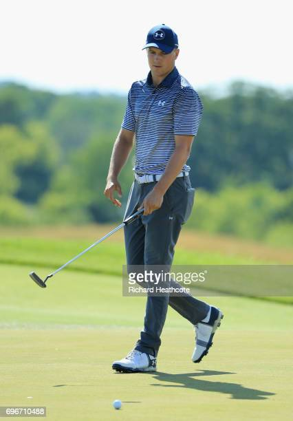 Jordan Spieth of the United States reacts after missing a putt on the eighth green during the second round of the 2017 US Open at Erin Hills on June...