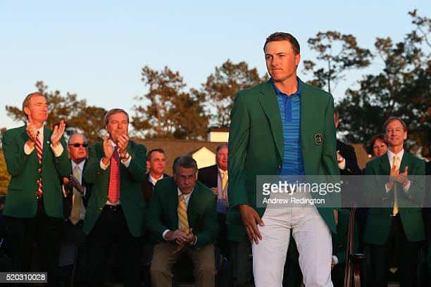 Jordan Spieth of the United States reacts after presenting Danny Willett of England with the green jacket following the final round of the 2016...